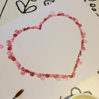 carte avec un coeur tampon